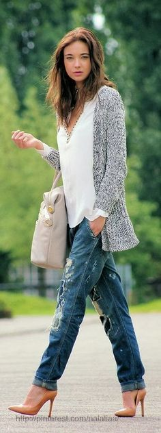 Might go with slightly less distressed jeans, but the combo of the colors and heels with slouchy sweater is great.