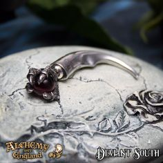 Last Chance! Alchemy Gothic E325 Dragon's Orb Claw Faux Stretcher (single)  Faux-stretch piercing dragon claw orb, pewter stretcher ear-stud, with surgical steel ear-post.
