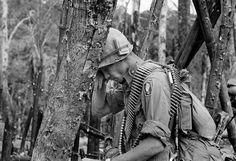 Weighted down with ammunition and other gear a trooper of the U.S. 173rd Airborne Brigade leans against a battered tree wiping the dust of battle from his eyes after the battle of Hill 875 came to an end during the week of Nov. 19, 1967. The Americans fought entrenched North Vietnamese troops for four days before taking the crest of the hill located near Dak To, South Vietnam, Nov. 23, 1967. / Credit: AP Photo