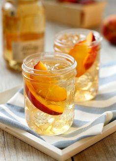 Front Porch Peach Tea - 2 parts Ole Smoky® Peach Moonshine™, 1 part Sweet Tea,1 part Lemonade, Garnish: Sliced peaches or mint