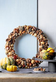 Not all fall wreaths have to be suspended outside. Display this DIY nut wreath on a fireplace mantel or entryway console table so you can enjoy its beauty every day. #falldecor #fallideas #wreathideas #fallwreath #wreath #bhg