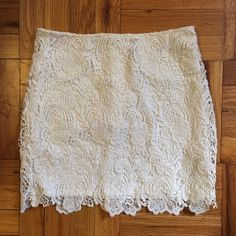 Brand new white lace mini skirt It doesn't have the tags but I never wore it! Very cute, bright white lace skirt. Zips in the back but is a little stretchy. H&M Skirts Mini