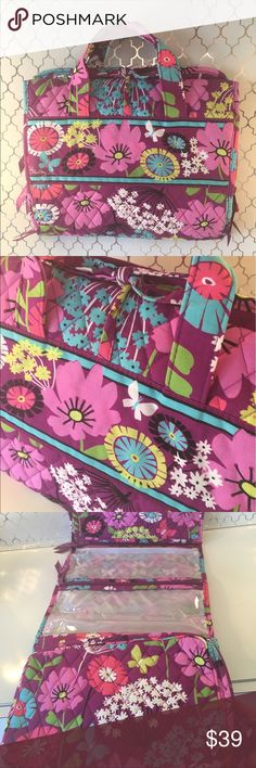 🆕VERA BRADLEY NEW TRAVEL BAG 💯AUTHENTIC VERA BRADLEY NEW NEVER USED XLARGE TRAVEL COSMETIC BAG 100% AUTHENTIC. STUNNING AND STYLISH TOTALLY ON TREND. PURCHASED AND NEVER USED! BEAUTIFUL MULTICOLORED AND PURPLE FLORAL PRINT. SO LARGE IT EVEN HAS A DOOR HANGING HOOK. OT HAS 4 LARGE INTERIOR COSMETIC COMPARTMENTS! WHEN OPEN IT MEASURES  29 INCHES LONG BY 12 INCHES WIDE. WHEN FOLDED UP IT IS 12 INCHES BY 10 INCHES. Vera Bradley Bags Cosmetic Bags & Cases