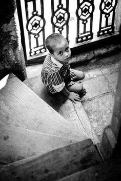 Kid playing on steps. shot at near Bhendi bazar/chor bazar mumbai.