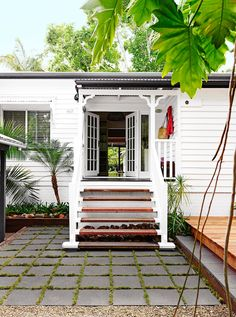 """To keep this north-Queensland home cool, the owners widened the front entrance by installing gorgeous French doors. Check out this [charming weatherboard renovation in Noosa](http://www.homestolove.com.au/gallery-charming-weatherboard-home-renovation-in-noosa-1618 target=""""_blank""""). Photo: Toby Scott / *homes+*"""