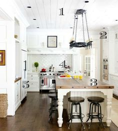 This gorgeous custom farmhouse-style kitchen might seem out of reach for the average homeowner.  Good news!  Many of the elements in this space can by achieved by the DIYer!  Find out how at Infarrantly Creative.