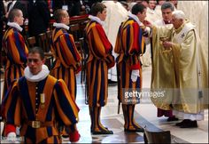 Swiss Guards taking communion from Pope Benedict.