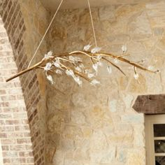 Organic and sculptural, the Portia 12-Light Chandelier creates an elegant focal point for any space. Graceful metal branches filled with delicate glass flowers are brightened by 12 candle bulbs concealed within the blooms. Slender wire hangers suspended from the turned ceiling canopy create the illusion of floating. The Portia is specially selected to complement the Tuscan-inspired finishes that make our Casa Florentina furnishings, fixtures and accessories so unique.