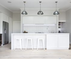 The classic look - replace the splash back with glass and add a smidgen of colour would be better.
