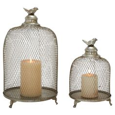 A perfect addition to your bookcase or sideboard, this candle lantern set showcases a round base, removable grill, and lovely bird finial.  ...