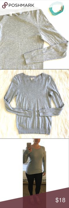 "Grey GAP Sweater Grey GAP Sweater. Perfect for the office or any day! Soft and super comfy. 70% cotton, 20% nylon, 10% silk. Size is xs. I'm usually a small so it's a little too small for me. Overall good used condition. Measures 16"" underarm to underarm and 24.5"" in length. Asks any questions! GAP Sweaters Crew & Scoop Necks"