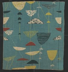 Furnishing fabric with abstracted calyx motifs in green, terracotta, yellow and undyed, on a turquoise ground  Place of Origin Great Britain, United Kingdom (made)  Date 1951 (made)  Artist/maker Day, Lucienne, born 1917 - died 2010 (designed)  Heals (manufacturer)  Materials and Techniques  Screen-printed linen  Marks and inscriptions  'Made in the United Kingdom'