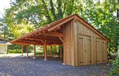 The timber frame carport even includes a potting shed with two doors. Built by B&D Builders in Wyncote, PA. www.custombarnbuilding.com
