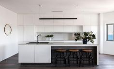 The apartment features luxury finishes such as American Oak floorboards and marble surfaces. Home Decor Kitchen, Kitchen Living, Kitchen Interior, Kitchen Ideas, Simon Baker, Black Kitchens, Home Kitchens, Kitchen Benches, Modern Kitchen Design