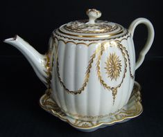 Worcester Teapot & Stand, circa 1770, gilded & decorated with festoons of husks & pattera