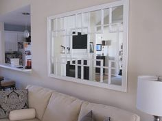 DIY trellis mirror - trim, double sided tape and molding ....  super easy
