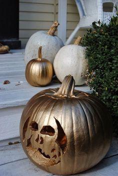 gold spray paint pumpkins
