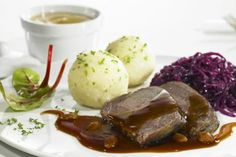 Sauerbraten (braised beef in vinegar) with red cabbage and potato dumplings - Foodcollection RF/Getty Images