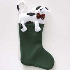 """Dog Christmas Stocking by Century Novelty. $5.98. The Classic Christmas Stocking with Style! The Dog Christmas stocking is great to use for special events and corporate promotions. And at these bulk wholesale prices, you can still afford to deck the halls. Plus, the quality of these stockings make them worthy to hang from your family's mantle. A green felt Christmas stocking trimmed with puppy dog topper. 16 1/2"""" tall from top to toe. 6 1/4"""" wide. Use dogs tail as a hook. For..."""