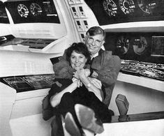 """Gene Roddenberry and Majel Barrett Roddenberry hanging out on the bridge of the U.S.S. Enterprise (as depicted in """"Star Trek IV: The Voyage Home"""")"""
