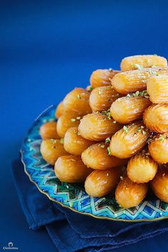 Grandma's Balah El Sham {Middle Eastern fluted fritters. This syrup soaked, churro-like pastry is crunchy on the outside and irresistibly squishy soft and fluffy on the inside.