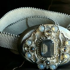 """Beautiful leather belt/ rhinestone embellished Measures at 33""""long. Belt can fit a size 24"""" waist - 28.5"""".  Gorgeous belt !! By Leather Rock.  Real genuine leather...Adjustable to almost any size. New condition,  hardly worn at all....Beautiful detailing.  Cream/ taupe color. Also can go on Merc for much less!  My invite code  ( XYVYBQ ) and you'll get a few dollars off your purchase aswell!  Lmk if any questions how to find the item on there! Leather Rock Accessories Belts"""