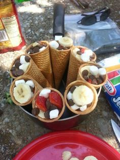 Waffle cones, marshmallow, chocolate chips, strawberry and bananas. Wrapped in foil and cooked on the campfire