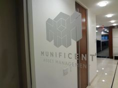 Custom frosted vinyl logo applied reverse from inside facing out onto clear glass office door in NYC. For more information, visit http://www.EtchedGlass.net