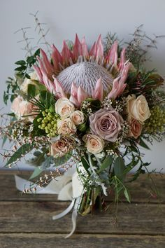 Wedding Flower Arrangements Kind Protea and rose bouquet, by Wedding Flowers by Keren Flor Protea, Protea Bouquet, Protea Flower, Beautiful Flower Arrangements, Wedding Flower Arrangements, Floral Arrangements, Beautiful Flowers, White Flowers, Ideas