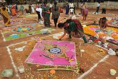 Women in Hyderabad, India, participate in a rangoli competition Wednesday. Rangoli is a traditional folk art from India in which artists create symbolic, decorative designs on the floors of living rooms and in front of doorways as a welcome for Hindu deities. Photo by Noah Seelam /AFP /Getty Images.