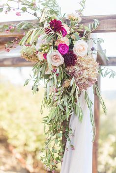 Classy whimsical flowers for the altar! View the full wedding here: http://thedailywedding.com/2015/12/19/classy-sunstone-winery-wedding-dave-morgan/