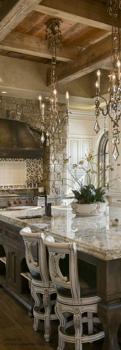 French Country Kitchen with raised ceiling boasting reclaimed timber beams and planking... The flared hood at stone arch is another lovely choice to blend the rustic with the refined...