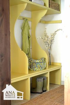 What a nice entry way... I love the yellow, and a spot for everyone's stuff. I would need to add more stations for our family, but I really like this. It makes room for more than one coat or pair of shoes which is great!
