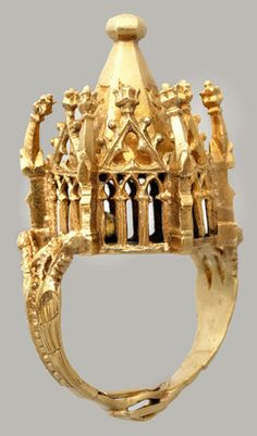 "14th century gold ""Jewish wedding ring shaped like a hexagonal building – symbolising both the marital home and the Temple of Jerusalem – with gothic arches, gables and a pyramidal roof on which is inscribed mazel tov (good wishes).... [Discovered in Erfurt, Germany, it was] most likely buried by Jews in fear of their lives during the Black Death when gentiles blamed them for causing the plague....1000 Erfurt Jews were slaughtered in one day in March 1349."" thehistoryblog.com"