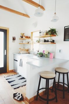 I love the light in the kitchen, pops of color and contrasting paint make a modern statement while being cozy.