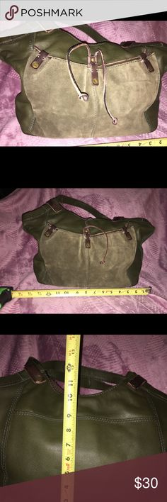 Lucky Brand purse This is a leather, hunter green with brown trim bag. It is very big and perfect for people like myself that tend to lean towards big bags. Lucky Brand Bags