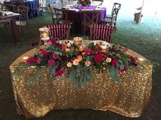 Sophisticated Wedding Sweetheart Table floral decor with fruit. Unique ombré effect. Pomegranate, peaches, grapes, pears, garden roses, spray roses, stock, anemones,  magnolia pods. Gold sequins linen. Design by Cloud 9 Wedding Flowers.