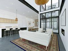 Con contraste de vigas negras y blanco, y cocina en madera y blanco y negro, integrada al espacio
