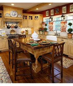 I think I have decided to paint and distress my kitchen cabinets a creamy white. would look nice with our red walls. by diann Cozy Kitchen, New Kitchen, Kitchen Dining, Kitchen Cabinets, Cupboards, Cream Cabinets, Kitchen Walls, Kitchen Island, Kitchen Ideas