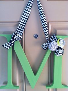 Hey, I found this really awesome Etsy listing at http://www.etsy.com/listing/122714521/wooden-initial-with-chevron-ribbon-and