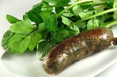 Watercress/Nettles Sausage - My project from yesterday being eaten for dinner. I'm trying different recipes for making Wild Food Sausages with local edible plants. This one is a watercress/nettles (locally foraged) sausage. It's vegetarian (no meat). I used beans and bread as a base and also garden/wild spices.