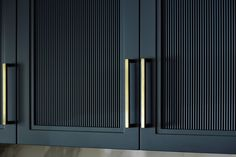The kitchen combines several styled doors, including these gorgeous reeded panels. The unlacquered antique brass handles compliment the striking units wonderfully. Wardrobe Door Designs, Wardrobe Design Bedroom, Wardrobe Doors, Modern Kitchen Design, Interior Design Kitchen, Glass Kitchen Cabinets, Reeded Glass, Minimalist Kitchen, Sliding Glass Door