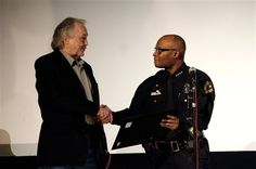 "John Brewer (man who spotted Oswald entering Texas Theatre and called police) awarded a ""Distinguished Citizen"" award by Dallas Police chief at the Texas Theatre"