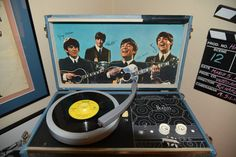 """BEATLES record player manufactured for NEMS in 1964. It plays! This is considered by most collectors to be one of the ultimate pieces to own of all commercial Beatles memorabilia. The 4-speed 17-1/2"""" x 10"""" x 6"""" NEMS record player was manufactered in 1964 and only 5000 were made, with very few surviving. So far, only a few near mint units have turned up - the majority that have surfaced are in worn condition.    This rare Beatles record player rarely comes to auction. Those who own them covet…"""