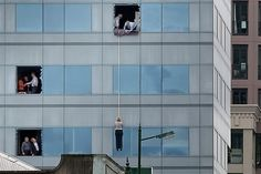 RESCUED: Office workers were lowered on ropes to escape the Forsyth Barr building when the stairs failed in the February quake.  The Forsyth Barr building's owners have not yet made a decision to demolish or repair the high rise across from Victoria Square.