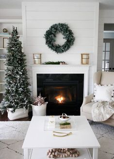 Beautiful winter white living room with lush holiday greenery.