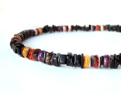 """50% off SALE Mens Jewelry - Men's necklace handmade from all natural, undyed black, red, orange and purple shell.  """"Island Sunset"""" on Etsy, $44.00"""