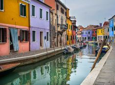 Street by Jure Kralj on 500px  #travel #street #streets #urban #architecture #colors #adventure #explore #doors #windows #city #town #center #photography #popular #europe #world #colorful #home #hometown #chill #walk #seasons #weekend #water #reflection #mirror #italy #burano #colour #bridge #boat