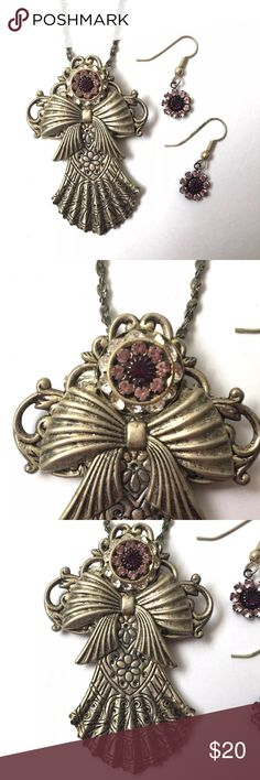"""Vintage Angel Brooch Pendant Necklace Earrings Vintage silver tone angel pendant necklace (also can be worn as a brooch pin) and pierced earrings set; pretty rhinestone purple flower detail; chain measures approx 18"""" long; pendant is approx 2-1/2"""" tall; shows some normal metal wear, chain could use a more thorough cleaning (see photos) Vintage Jewelry Necklaces"""