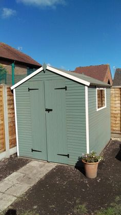 Shed painted in Cuprinol Wild Thyme with Pale Jasmine for edging.